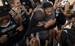 Chicago Skys Candice Parker, coach James Wade and teammates celebrate after defeating the Connecticut Sun 79-69 in Game 4 of a WNBA basketball semifinal series Wednesday, Oct. 6, 2021, in Chicago.