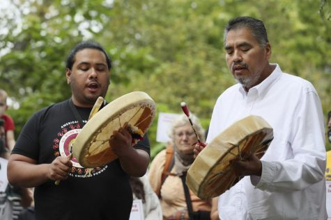 Sergio Ceron and Dave Spencer beat Native American drums during a gathering in support of Indigenous Peoples Day in Potawatomi Park on Monday, Oct. 11, 2021 in Chicago.