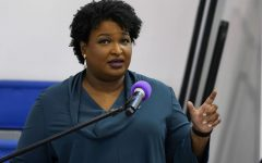 Stacey Abrams encourages voters to vote at a church service in Norfolk, Va. on Oct. 17, 2021 (Steve Helber/AP)