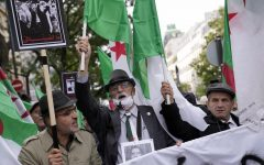 Demonstrators holding Algerian flags chant slogans on Oct. 17 to commemorate 60th anniversary of 1961 massacre. AP Photo