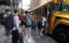 Students board a school bus on New Yorks Upper West side, pandemic disruptions remain inevitable as students return in-person. (Richard Drew | Associated Press)