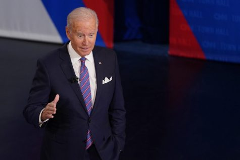 President Joe Biden participates in a CNN town hall at the Baltimore Center Stage Pearlstone Theater, Oct. 21, 2021 in Baltimore, with Anderson Cooper (Evan Vucci | Associated Press)