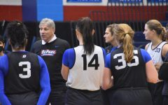 The DePaul womens basketball team gather around to listen to head coach Doug Bruno at their open practice on Saturday.