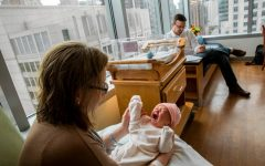 Katie Bambacht holds her 2-day-old daughter, Evie, in a room with her husband, Zachary, in Prentice Womens Hospital in Chicago. (Zbigniew Bzdak/Tribune Photo)