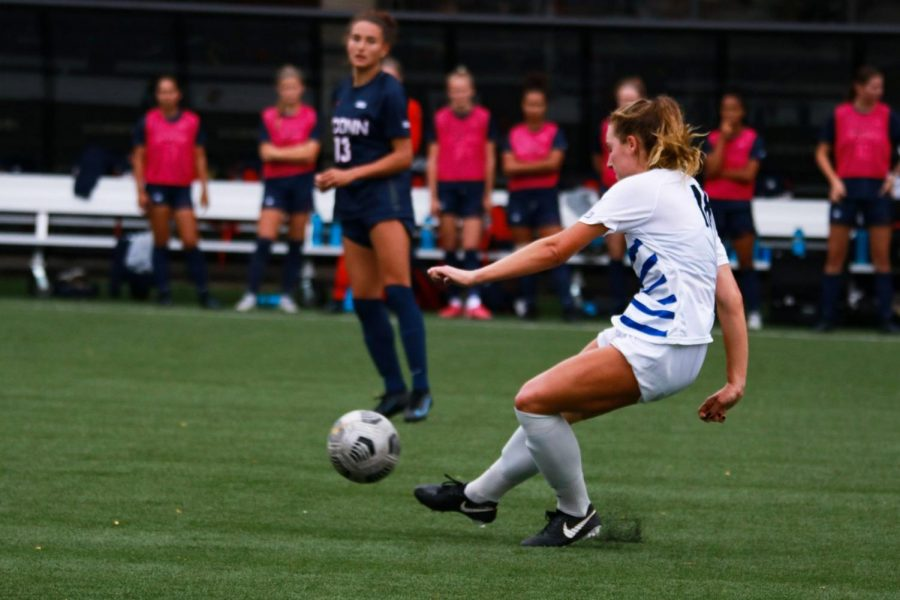 Defender Megan Malecha kicking the ball away during their game against UConn.