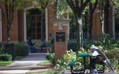 A student sits at Saint Vincent's Circle in DePaul's Lincoln Park campus. Students have returned to campus after a full year of online classes due to Covid-19.