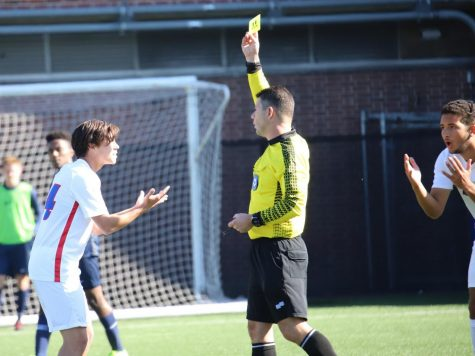 Two DePaul soccer players argue a yellow card decision on Sunday at Wish Field.
