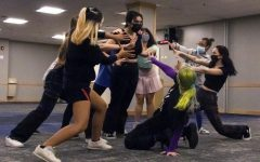 DePaul students dance to Kpop in the Student Center.