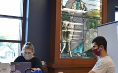 Students study at DePaul's John T. Richardson Library in Lincoln Park, a building filled with religious imagery.