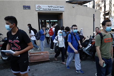 Students leave their school in Beirut, Lebanon, Wednesday, Sept. 29, 2021. (AP Photo/Bilal Hussein)