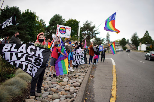 The Newberg Education Association gathers with community members ahead of the Newberg School Board vote on whether to ban Black Lives Matter and Pride flags at the school, Tuesday, Sept. 28, 2021, in Newberg, Ore. (Beth Nakamura/The Oregonian via AP).