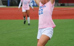 Grace Phillpotts preparing to throw in the ball at the DePaul womens soccer Pink Out game on Oct. 21.